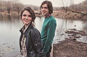 foto of early spring  - young happy loving couple walking in early spring country side - JPG
