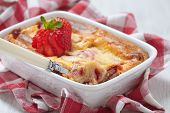 foto of crepes  - Strawberry crepes roll baked with cheesecake sauce - JPG