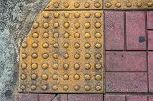 picture of paved road  - image of close up at Tactile paving texture for blind handicap on the road - JPG