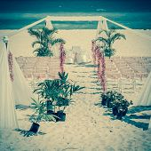 picture of altar  - Vintage style photo of wedding altar on the beach - JPG