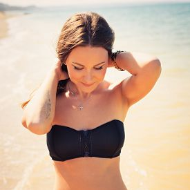 stock photo of bathing  - Woman with beautiful body on a tropical beach - JPG