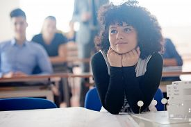 stock photo of classroom  - portrait of young female student at school classroom - JPG