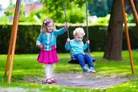 stock photo of playground school  - Little boy and girl on a playground - JPG
