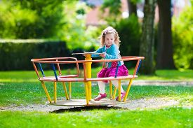 picture of daycare  - Little girl on a playground - JPG