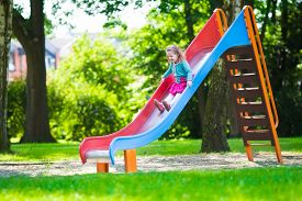 stock photo of daycare  - Little girl on a playground - JPG