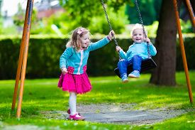image of daycare  - Little boy and girl on a playground - JPG
