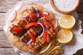 pic of souvlaki  - Greek souvlaki with pita bread and vegetables close - JPG