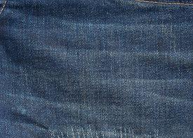 foto of denim jeans  - blue denim jeans texture background - JPG