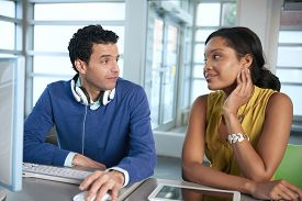 foto of coworkers  - Couple of business coworkers collaborating on a project in a bright glass office - JPG