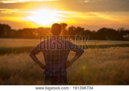 Rear View Of Farmer In