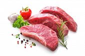 Pieces of raw roast beef meat with ingredients for grilling isolated on white poster