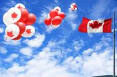 Canadian maple leaf flag and balloons in the sky for Canada day.  poster