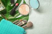 Composition with cosmetics and green tropical leaf on light background. Natural cosmetics concept poster