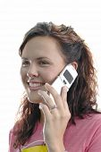 Young woman talking on the cell phone with white background