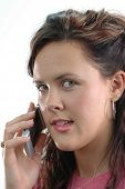 Close up of girl on the cell phone with white background