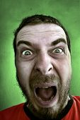 picture of outrageous  - Portrait of shouting shocked man - JPG
