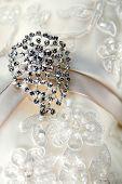 Silver brooch on luxury vintage wedding dress