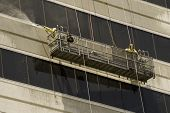 stock photo of pressure-wash  - Window Washers Pressure Washing an Office Building - JPG