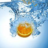 orange splash in water
