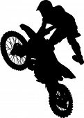 man hitting jump on dirt bike