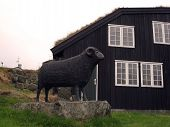 image of faroe islands  - Statue of a Black Ram is symbolic of one of the two main industries of Torshavn Faroe Islands - JPG