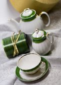 white with green tea service and gift box on napkin
