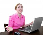 Woman Working At A Laptop Very Confused