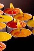 flaming candles on a dark background