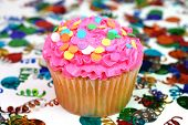 image of sweet sixteen  - Celebration or birthday cupcake with confetti in background - JPG