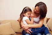picture of pity  - prety mother soothing and hugging crying baby girl - JPG