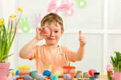 Little Child Boy With Easter Bunny Ears Painting Easter Eggs At Home. Adorable Child Prepare For Eas poster