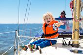 Kids Sail On Yacht In Sea. Child Sailing On Boat. Little Boy In Safe Life Jackets Travel On Ocean Sh poster
