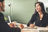 Businessman And Businesswoman In Meeting Room. poster
