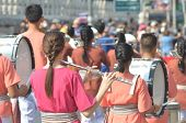 Young Girl Wear Thai Traditional Suit Playing Flute For Show In Marching Band Paraded On Street With poster