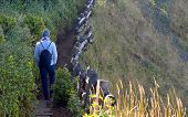 Traveler Traveling On Footpath Beside A Cliff, Ecotourism In Beautiful Nature Environment In Trail O poster