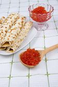 Pancakes With Red Caviar On A Plate.