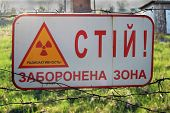 Chernobyl area. Lost city Pripyat. Sign - Stop,Restricted area,Radioactive. - in Ukrainian. Modern r