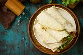 Healthy Lunch Snack. Tortilla Wraps With Grilled Chicken And  Fresh Vegetables On Blue Table. Chicke poster