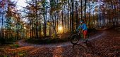 Mountain biker riding on bike in spring mountains forest landscape. Man cycling MTB enduro flow trai poster