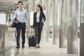 Business Man And Woman  Dragging Suitcase Luggage Bag,walking To Passenger Boarding In Airport,trave poster