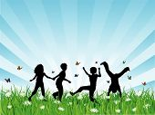 stock photo of children playing  - Silhouettes of children playing in grass  - JPG