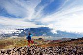 Tourist Admiring Breathtaking View Of Mauna Loa Volcano On The Big Island Of Hawaii. poster