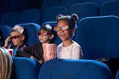 Cheerful, Joyful Children Sitting In Cinema Theatre, Enjoying Movie Or Cartoon. Kids Wearing In 3d G poster