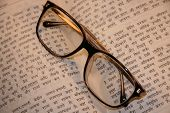 Old-Fashioned Eyeglasses On Hindi Text