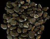 River Rocks Against Black