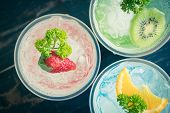 Red Green Blue Italian Soda Cold Beverage And Strawberry Kiwi Lemon Fruit And Parsley. Red Green Blu poster