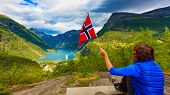 Tourism Vacation And Travel. Female Tourist Enjoying Beautiful View Over Magical Geirangerfjorden Fr poster