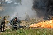 image of flamethrower  - German soldier with flame - JPG