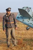 KIEV, UKRAINE -NOV 6: Unidentified member of Red Star history club wears historical German Luftwaffe uniform during historical reenactment of WWII, November 6, 2011 in Kiev, Ukraine