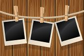 picture of clotheslines  - Blank photos hanging on a clothesline against a wooden wall - JPG